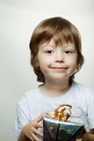 Happy boy with gift-box Stock Image