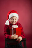 Happy boy with gift-box Stock Photography