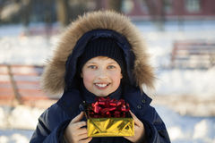 Happy boy with gift box Stock Images