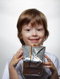 Happy boy with gift box. On white Royalty Free Stock Photography