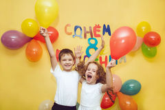 Happy boy and girl with balloons at happy birthday party. Stock Photography