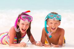 Happy boy and girl on beach Stock Image