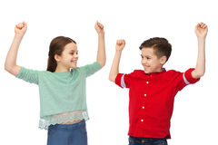 Happy boy and girl celebrating victory Stock Image