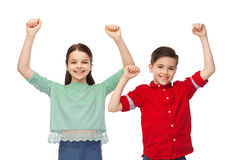 Happy boy and girl celebrating victory Royalty Free Stock Images