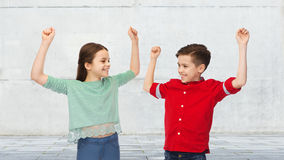 Happy boy and girl celebrating victory Stock Photography
