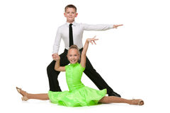 Happy boy and girl are dancing Stock Photos