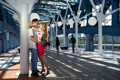 Happy boy and girl on date on pedestrian bridge Stock Photos