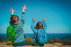 Happy boy and girl enjoy travel in nature, looking at view. Family vacation stock photos