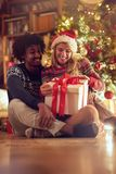 Happy boy and girl exchanging Christmas presents royalty free stock photos
