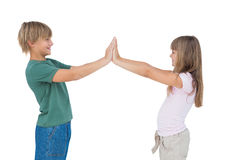 Happy boy and girl high fiving Stock Images