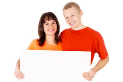 Happy boy and a girl holding the poster Royalty Free Stock Photography