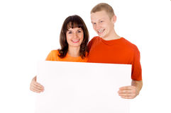 Happy boy and a girl holding the poster Royalty Free Stock Photo