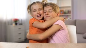 Happy boy and girl hugging, brother sister closeness, tender family relations royalty free stock photography
