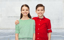 Happy boy and girl hugging Stock Image