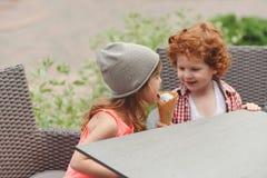 Happy boy and girl with icecream. Little happy boy and girl with icecream Stock Photography
