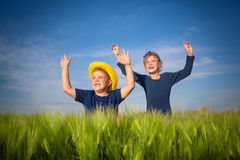 Happy boy and girl  in the middle of wheat fields Stock Photography