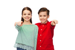 Happy boy and girl pointing finger to you Stock Photography