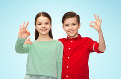Happy boy and girl showing ok hand sign Royalty Free Stock Photography
