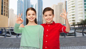 Happy boy and girl showing ok hand sign Stock Photos