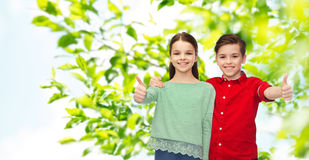 Happy boy and girl showing thumbs up Royalty Free Stock Image