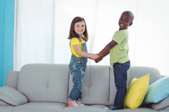 Happy boy and girl standing up Royalty Free Stock Photo