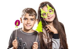 Happy boy and girl, try on funny masks. Two teenagers have fun, and try on funny masks Stock Photography