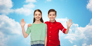 Happy boy and girl waving hand Royalty Free Stock Photos