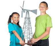 Happy boy and girl with windmill Stock Photography