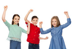 Happy boy and girls celebrating victory Stock Photography