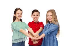 Happy boy and girls with hands on top Stock Photo