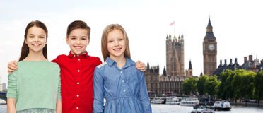 Happy boy and girls hugging over london Royalty Free Stock Images