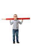 Happy boy in glasses and bowtie posing with a huge pencil. Educational concept. Isolated over white. Stock Photo