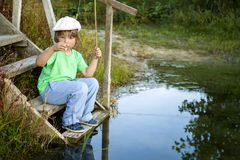 Happy boy go fishing on the river, one children fisherman with a Royalty Free Stock Image