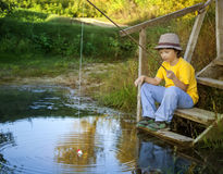 Happy boy go fishing on the river, one children fisherman with a Royalty Free Stock Photos