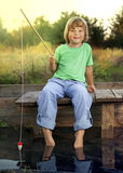 Happy boy go fishing on the river, one children fisherman with a Stock Photos