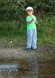 Happy boy go fishing on the river, one children fisherman with a Royalty Free Stock Photography