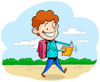 Happy boy going to school. Happy young student schoolboy walking and reading a book going to school Stock Photography