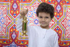 Happy Boy with Golden Lantern Celebrating Ramadan Stock Images