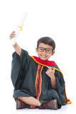 Happy boy in graduation suit Stock Photography