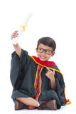Happy boy in graduation suit Royalty Free Stock Photography