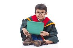 Happy boy in graduation suit Stock Image