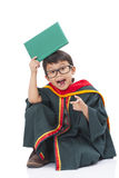 Happy boy in graduation suit Stock Photo