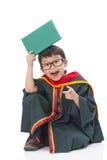 Happy boy in graduation suit Stock Photo