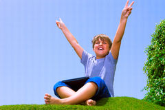 Happy boy on the grass with tablet computer Stock Images