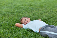 Happy boy on the green grass Royalty Free Stock Photography