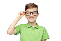 Happy boy in green polo t-shirt and eyeglasses Stock Photography