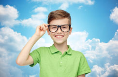 Happy boy in green polo t-shirt and eyeglasses Royalty Free Stock Photography
