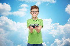 Happy boy in green polo t-shirt holding eyeglasses Royalty Free Stock Photography