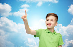 Happy boy in green polo t-shirt pointing finger up Royalty Free Stock Images