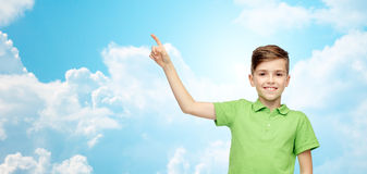 Happy boy in green polo t-shirt pointing finger up Royalty Free Stock Photo